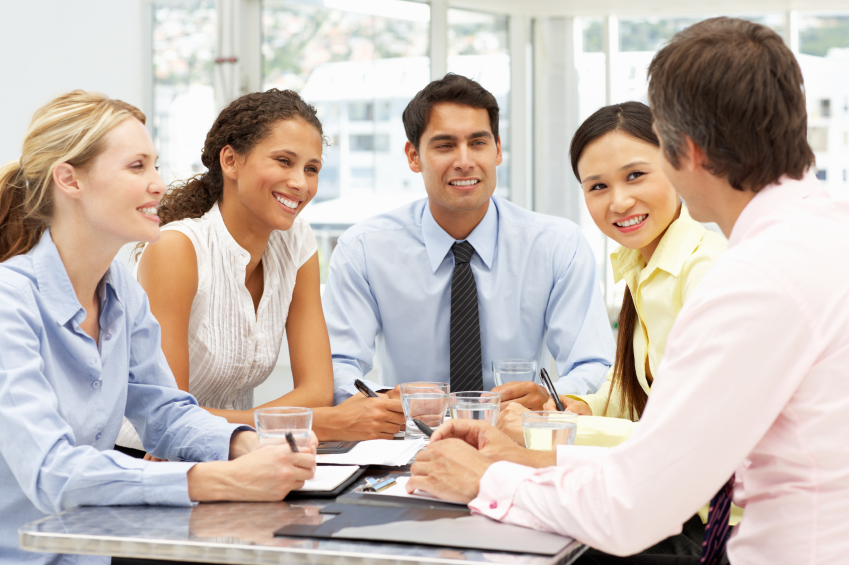 image: Diverse business people discussing something with professional coworkers
