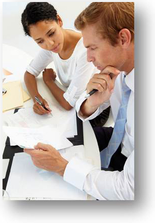 Image: Business man and woman working together at office